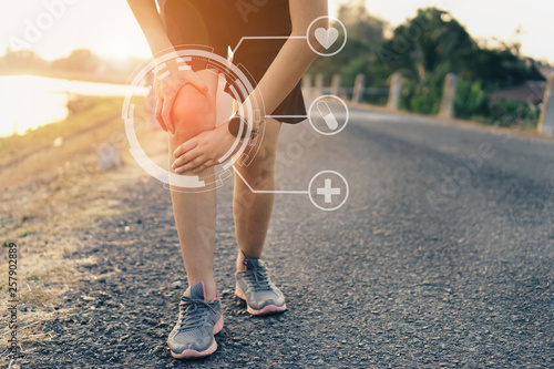Fotografie, Tablou  Runners leg pain, man holding sore and over trained painful leg muscle or cramp