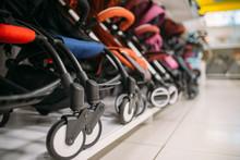 Row Of Baby Strollers On Shelf...