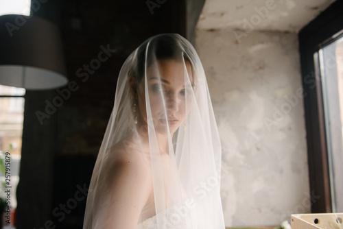 Bride posing close up in a veil Fototapeta