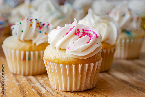 Mini cupcakes decorated with spring and Easter candy sprinkles фототапет