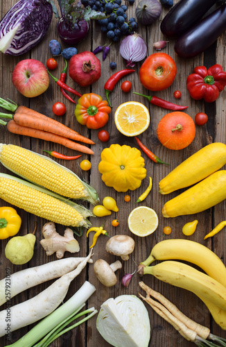 Fotografie, Obraz Yellow, orange, red, purple fruits and vegetables on wooden background