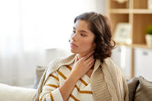 Cold And Health Problem Concept - Unhappy Sick Woman With Sore Throat At Home