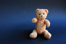Brown Toy Soft Bear On Black Background Childhood Concept