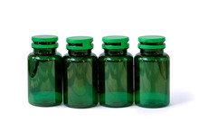 Row Of Blank Packaging Plastic Supplement Green Bottle Isolated On White Background