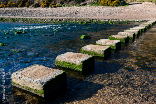 Obraz na plátně  Three Cliffs Bay stepping stones The stepping stones that allow access over the