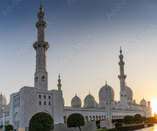 Fotografia  Arabic mosque facade with domes, with sunset light