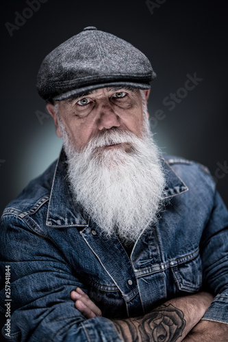 Obraz na plátne studio portrait of a senior hipster with a long white beard