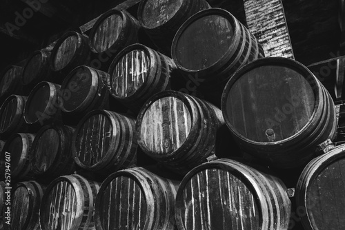 Obraz na plátně Barrels for whiskey or wine stacked in the cellar