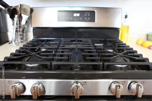 Modern stainless steel gas stove oven in a home kitchen.
