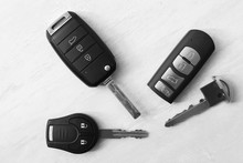 Flat Lay Composition With Different Car Keys On Light Background, Top View