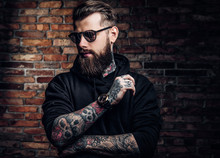 A Stylish Tattooed Guy In A Bl...
