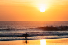 Indonesia, Bali, Sunset At Ocean, Surfer At The Beach