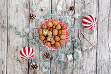 Walnuts On A Plate With Christmas Decoration, Overhead View