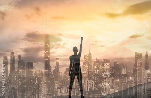 Strong confident woman in the city with her fist up in the air Fototapeta