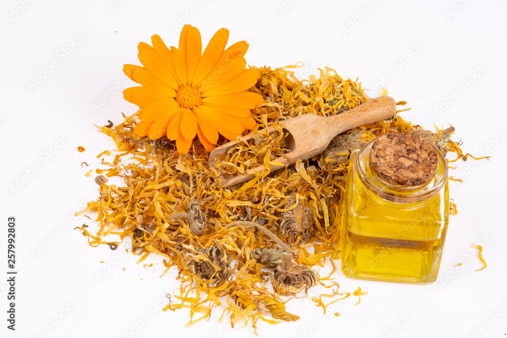 Fototapety, obrazy: Herbal calendula officinalis in the glass and drop oil Isolated