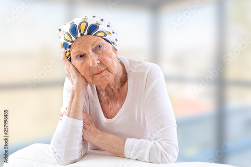Fotografie, Obraz Portrait of mature woman recovering after chemotherapy and looking at camera