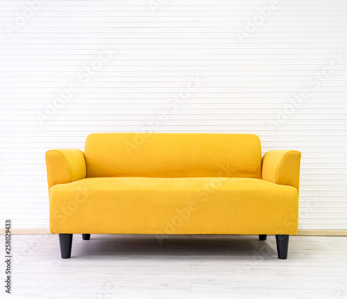 Yellow modern comfortable sofa in living room apartment with white ...