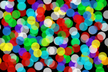 Seamless Background Beautiful Bokeh From Colored Circles.