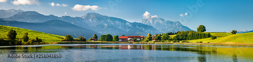 Panoramic bavarian landscape with small village by a lake, the alps behind, Allg Canvas Print