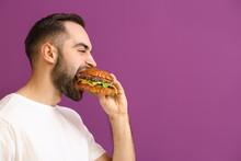 Man Eating Tasty Burger On Col...