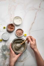 Woman Preparing Cosmetic Clay ...