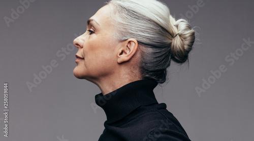 Obraz na plátně Senior woman on grey background