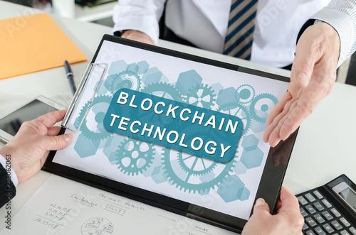 Foto auf Leinwand Indien Blockchain technology concept on a clipboard