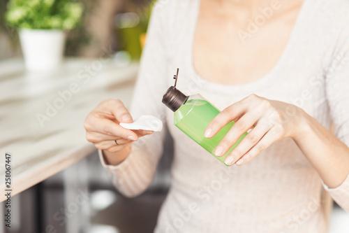 Makeup remove skin care  Closeup woman holding cotton swab
