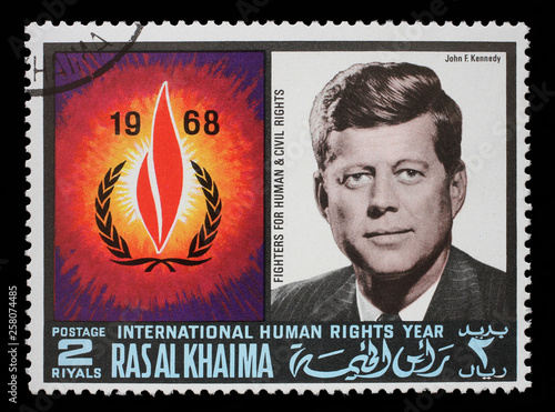 Papel de parede Stamp issued in the Ras al Khaimah shows John F