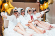 canvas print picture - Bathrobe party girls taking selfie. Females leisure and lifestyle. Sunglasses and towel turbans on. Festive balloons decor.