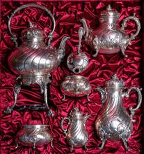 Vintage Silver Tea Set On A Red Background.
