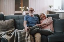 Happy Elder Couple Enjoying Time Together At Home