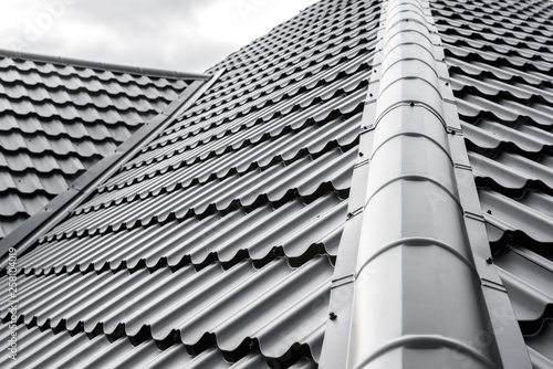 Construction of the roof of the house. Metal tiles. Fototapeta