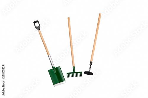 Stampa su Tela Small gardening rake, hoe and shovel isolated on white background