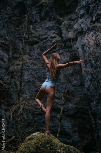 Young woman is doing yoga the cave system Rakov Skocjan in Slovenia - 258109437