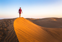 Girl Walking On Sand Dunes In ...