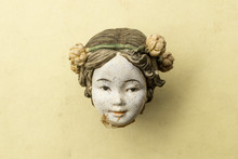 Detail Of An Old Damaged Porcelain Chinese Doll Head