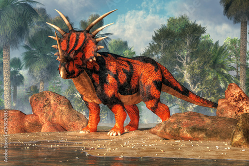 Photo  A red and black sytracosaurus stands on the sandy shores of a cretaceous era lake