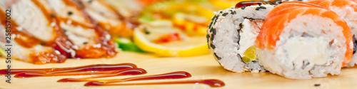 Fotomural  Rainbow Sushi Roll with salmon, eel, tuna, avocado, royal prawn, cream cheese Philadelphia, caviar tobica, chuka