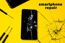 Broken Smartphone On A Yellow Background. Copy Cpace For Text