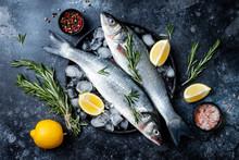 Fresh Raw Seabass Fish On Blac...