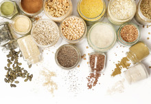 Top View Of Jars With Grains, Seeds, Legumes, Flours And Various Food Ingredients. Healthy Food Concept.