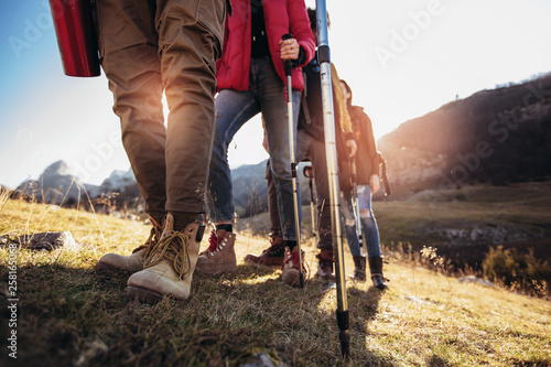 Fototapeta Hiking man and woman with trekking boots on the trail obraz