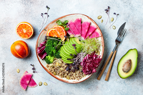 Photographie Vegan, detox Buddha bowl with quinoa, micro greens, avocado, blood orange, broccoli, watermelon radish, alfalfa seed sprouts