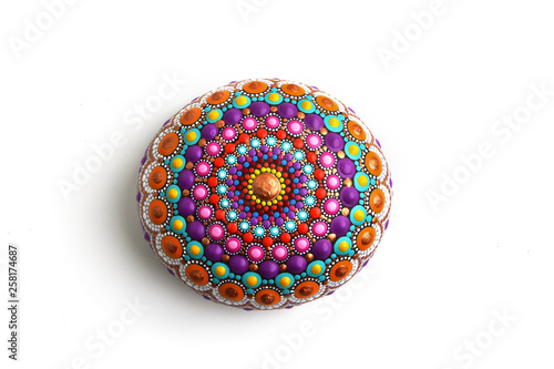 Photo  Beautiful mandala hand painted on a sea stone, isolated