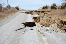 A Road Is Destroyed By Erosion Caused By Spring Runoff.