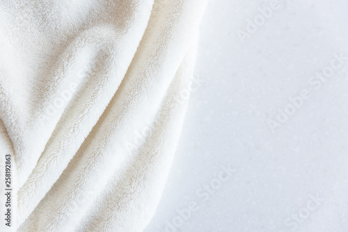 White delicate soft  background of plush fabric on white table Fototapete