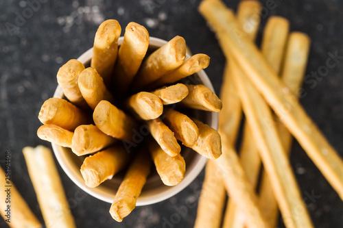 Valokuva  Italian grissini breadsticks. Tasty grissini snack.