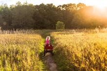 Girl Pulling Wagon In Field