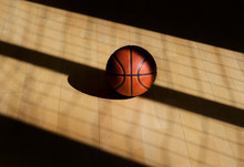 Basketball Ball On The Parquet With Black Background
